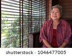 cheerful elder senior resting... | Shutterstock . vector #1046477005