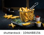 french fries close up with... | Shutterstock . vector #1046488156