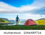 angler stands on the coast of a ... | Shutterstock . vector #1046489716