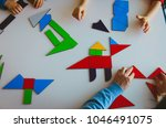 teacher and kids play with... | Shutterstock . vector #1046491075