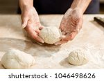 cropped shot of baker holding... | Shutterstock . vector #1046498626