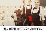 a large group of waiters and... | Shutterstock . vector #1046500612