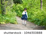 little girl posing in the park... | Shutterstock . vector #1046503888