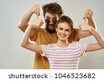 young couple on a light... | Shutterstock . vector #1046523682