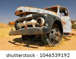 old and rusty car wreck at the... | Shutterstock . vector #1046539192