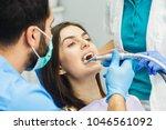 smiling beautiful patient... | Shutterstock . vector #1046561092