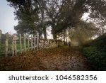 a pilgrim with a stick walking... | Shutterstock . vector #1046582356