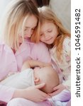 mom blonde with older daughter...   Shutterstock . vector #1046591482
