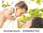 young father lift and playing...   Shutterstock . vector #1046662762