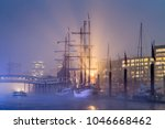hamburg harbor  germany  with a ... | Shutterstock . vector #1046668462