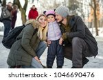 two young happy parents pose...   Shutterstock . vector #1046690476