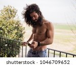 man with long hair typing with... | Shutterstock . vector #1046709652