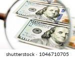 100 us dollar banknotes under...   Shutterstock . vector #1046710705