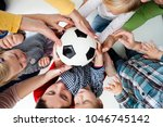 children stretch to the ball | Shutterstock . vector #1046745142