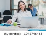 intern at the office working on ... | Shutterstock . vector #1046746465