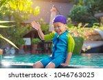 little asian girl wearing swim... | Shutterstock . vector #1046763025