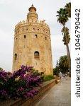 torre del oro next to river... | Shutterstock . vector #1046790442