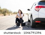 portrait of upset young woman... | Shutterstock . vector #1046791396