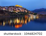 """LESVOS (or """"MYTILENE"""") ISLAND, NORTH AEGEAN, GREECE. Night view of Molyvos town and its castle."""