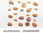 nuts and almonds on a white... | Shutterstock . vector #1046846485