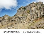 broken rocks at hillside at the ... | Shutterstock . vector #1046879188