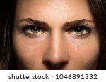 Small photo of Beautiful and powerful intense staring eyes of confidence and courage in female close up