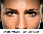 expressive female eyes during... | Shutterstock . vector #1046891335