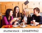 informal meeting friends in cafe   Shutterstock . vector #1046894962