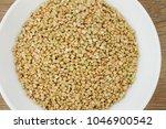 green buckwheat on the white... | Shutterstock . vector #1046900542