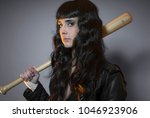 Small photo of custody, adolescence and delinquency, brunette woman in leather jacket and baseball bat with challenging aptitude