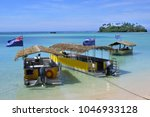 landscape view polynesian boats ... | Shutterstock . vector #1046933128
