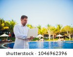 working on laptop from the...   Shutterstock . vector #1046962396
