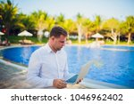 working on laptop from the...   Shutterstock . vector #1046962402