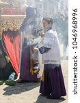 Small photo of Marchena, SEVILLE, SPAIN - March 25, 2016: Procession of Holy Week(Semana Santa) in Marchena, SEVILLE. Holy Friday. Monaguillo (altar boy) fanning incense
