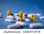 miniature hazmat team inspects... | Shutterstock . vector #1046971978