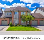 custom built luxury house in... | Shutterstock . vector #1046982172