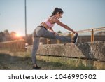 portrait of a young fit woman... | Shutterstock . vector #1046990902