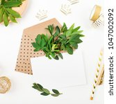 styled desk with envelope ... | Shutterstock . vector #1047002092