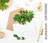 styled desk with envelope ... | Shutterstock . vector #1047002092