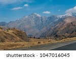 majestic high mountains under... | Shutterstock . vector #1047016045