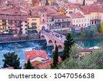 ponte pietra bridge on adige... | Shutterstock . vector #1047056638