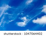 High white  wispy cirrus  and cirrostratus clouds  in the azure  blue Australian sky  sometimes called mare