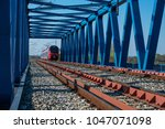 electric train  on the dusk at... | Shutterstock . vector #1047071098