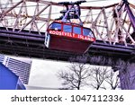 Small photo of Roosevelt Island Gondola Tram in New York City with the Ed Koch Queensboro Bridge in the Background