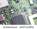 closeup circuit board with... | Shutterstock . vector #1047114052
