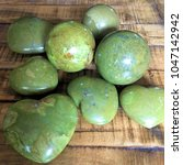 green opal crystal heart on... | Shutterstock . vector #1047142942