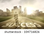 Businessman walking on the highway road to new city, symbolizing as the way to the new success - stock photo