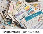 pile of written postcards in... | Shutterstock . vector #1047174256