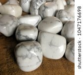 white howlite tumbled crystals | Shutterstock . vector #1047176698
