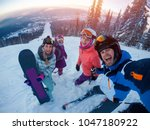 skiing on ski team of friends... | Shutterstock . vector #1047180922